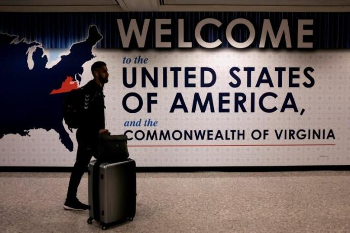An international passenger arrives at Washington Dulles International Airport after the U.S. REUTERS