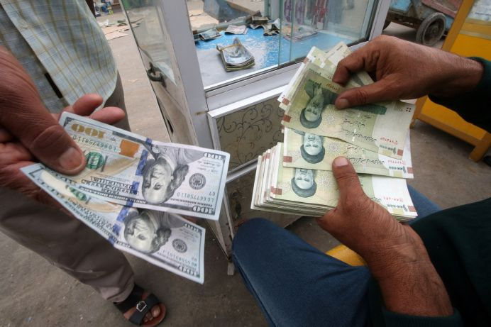 Iranian rials, U.S. dollars and Iraqi dinars are seen at a currency exchange shop in Basra, Iraq November 3, 2018. REUTERS/Essam al-Sudani
