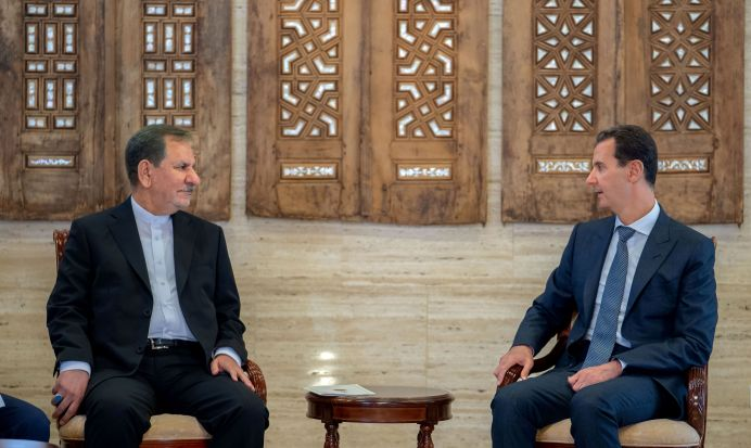 FILE PHOTO: Eshaq Jahangiri meets with Bashar al-Assad in Damascus, Syria. REUTERS./