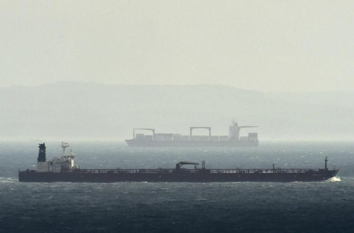 Cargo ships are seen as they sail across the English Channel with the French coast on the horizon, from Dover in Britain. REUTERS