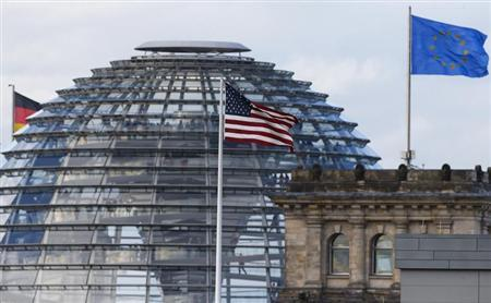 The flag on the U.S. embassy is pictured next to the Reichstag building, seat of the German lower house of parliament Bundestag, in Berlin. Reuters