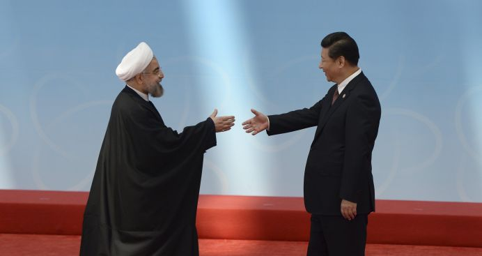 FILE PHOTO: Iran's President Hassan Rouhani (L) shakes hands with his Chinese counterpart Xi Jinping. REUTERS