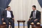 FILE PHOTO: Syria's President Bashar al-Assad (R) meets Admiral Ali Shamkhani. Reuters