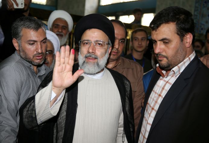 FILE PHOTO: Iranian presidential candidate Ebrahim Raisi gestures as he casts his vote during the presidential election in Tehran, Iran, May 19, 2017. TIMA via REUTERS