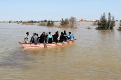 People are seen on a boat after a flooding in Golestan province, Iran, March 24, 2019. Picture taken March 24, 2019. Reuters