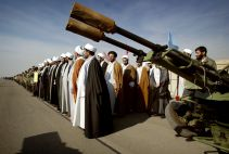 Iranian clerics stand at a military base during a rally to commemorate Basij week after creating a human chain in support of Iran's nuclear programme in Tehran. REUTERS/FILE PHOTO./