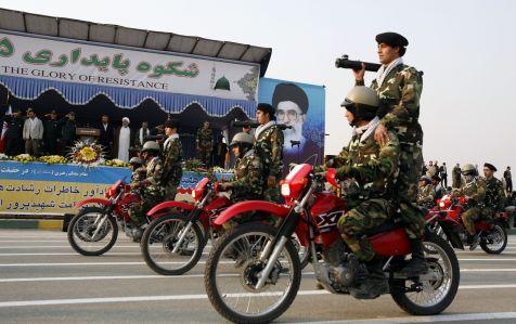 FILE PHOTO: Basij paramilitary volunteers during their parade ceremony in front of the shrine of Iran's late leader Ayatollah Ruhollah Khomeini mausoleum south of Tehran. REUTERS/Raheb Homavandi