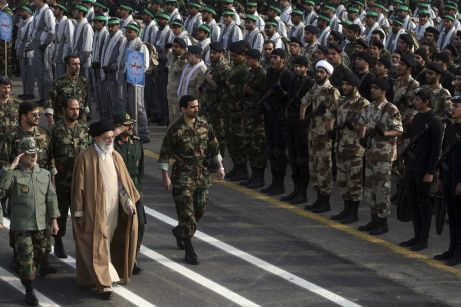 FILE PHOTO: Iran's Supreme Leader Ayatollah Ali Khamenei (2nd L) inspects the parade by the members of Basij militia part of IRGC (paramilitary volunteer) during a ceremony to mark the Basij day in southern Tehran. Reuters