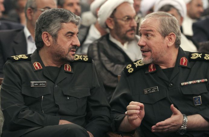 FILE PHOTO: Revolutionary Guards commanders Yahya Rahim Safavi (R) speaks with commander Mohammad Ali Jafari. Reuters