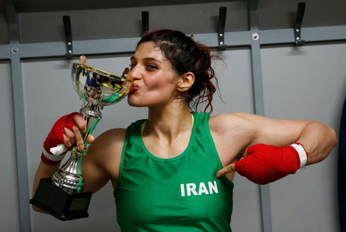 Iranian boxer Sadaf Khadem poses in the locker room after winning the fight against French boxer Anne Chauvin during an official boxing bout in Royan, France, April 13, 2019. REUTERS/Stephane Mahe