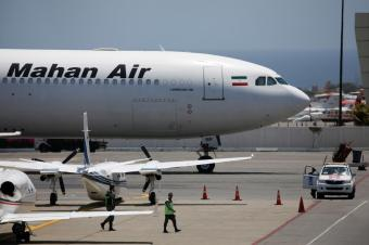 FILE PHOTO: An Airbus A340 airplane of Mahan Air is seen at Simon Bolivar International Airport outside Caracas, Venezuela April 8, 2019. REUTERS/Carlos Garcia Rawlins