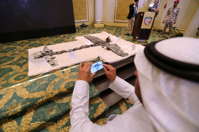 FILE PHOTO: A Saudi man takes photos of Iran-aligned Houthi drones, brought down over Jizan and Abha. REUTERS/Hamad I Mohammed