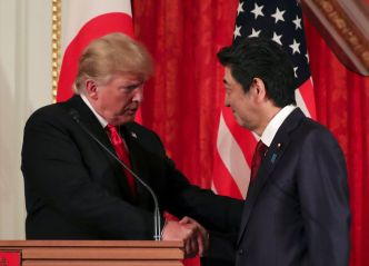 FILE PHOTO: U.S. President Donald Trump shakes hands with Japan's Prime Minister Shinzo Abe during a joint news conference, at Akasaka Palace in Tokyo, Japan May 27, 2019. REUTERS/Athit Perawongmetha