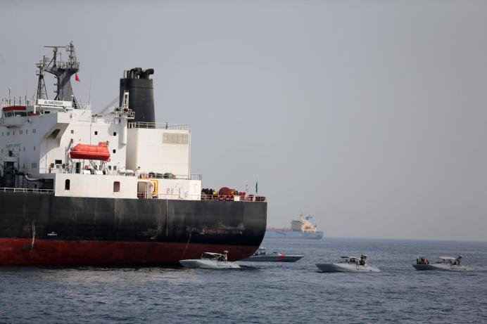 UAE Navy boats are seen next to Al Marzoqah, Saudi Arabian tanker, off the Port of Fujairah, UAE May 13, 2019.REUTERS/Satish Kumar