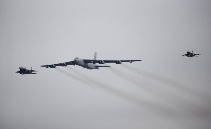FILE PHOTO: A U.S. Air Force B-52 (C) flies over Osan Air Base in Pyeongtaek, South Korea, in this January 10, 2016 file photo. REUTERS/Kim Hong-Ji