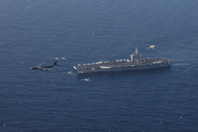 United States aircraft carrier Abraham Lincoln (CVN 72) and a U.S. Air Force B-52H Stratofortress, deployed to the region, conduct joint exercises in Arabian Sea, June 1, 2019. Picture taken June 1, 2019. Brian M. Wilbur/U.S. Navy/Handout via REUTERS