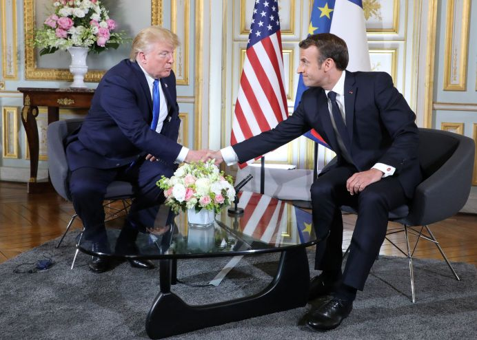 U.S. President Donald Trump and French President Emmanuel Macron speak during a meeting at the Prefecture of Caen, Normandy, France June 6, 2019, on the sidelines of D-Day commemorations marking the 75th anniversary of the World War II Allied landings in Normandy. Ludovic Marin/Pool via REUTERS