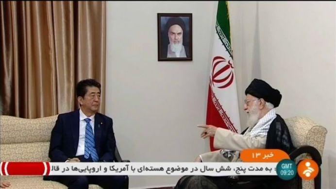FILE PHOTO: Abe (L) meets with Khamenei (R). Reuters