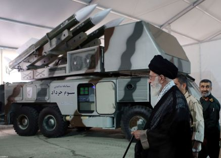 """Iran's Supreme Leader Ayatollah Ali Khamenei is seen near a """"3 Khordad"""" system which is said to had been used to shoot down a U.S. military drone, according to news agency Fars, in this undated handout picture. REUTERS"""