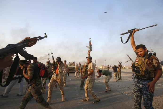 FILE PHOTO: Iraqi Shiite militia fighters. Reuters