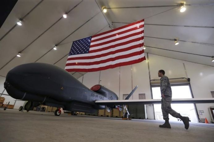 FILE PHOTO - A U.S. Air Force maintainer makes his way into a hangar packed with RQ-4 Global Hawk aircraft. REUTERS/Hamad I Mohammed