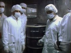 FILE PHOTO: Video grab shows workers standing next to a barrel of yellow uranium cake before feeding it into the processing line of the Uranium Conversion Facility in Isfahan, 420 km (261 miles) south of Tehran. REUTERS./