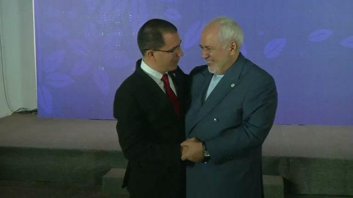 Venezuelan Foreign Minister, Jorge Arreaza, Embracing Iranian Foreign Minister, Mohammad Javad Zarif. REUTERS