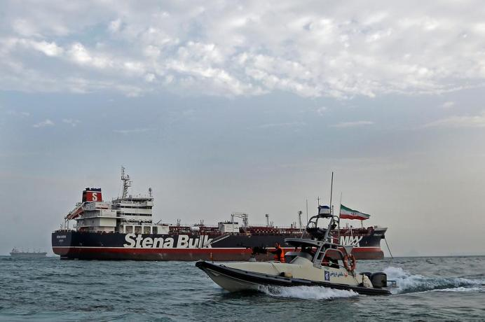FILE PHOTO: A boat of Iranian Revolutionary Guard sails next to Stena Impero, a British-flagged vessel owned by Stena Bulk, at Bandar Abbas port, in this undated handout photo. REUTERS./