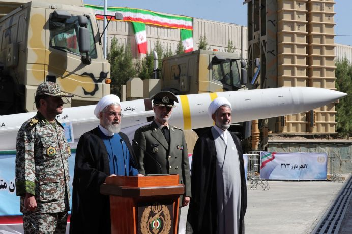 FILE PHOTO: Iranian President Hassan Rouhani delivers a speech during the unveiling ceremony for the domestically built mobile missile defence system Bavar-373, to mark the National Defence Industry Day in Tehran, Iran August 22, 2019. Reuters./