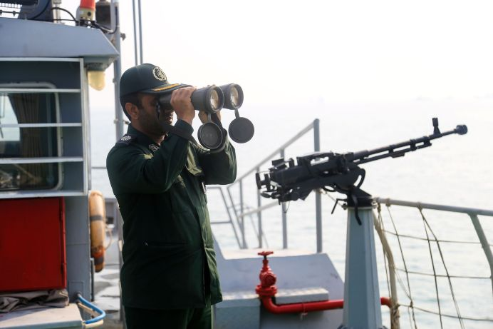 An IRGC officer looks through binoculars on a boat in coastal water during the annual military parade in Bandar Abbas, Iran September 22, 2019. REUTERS./