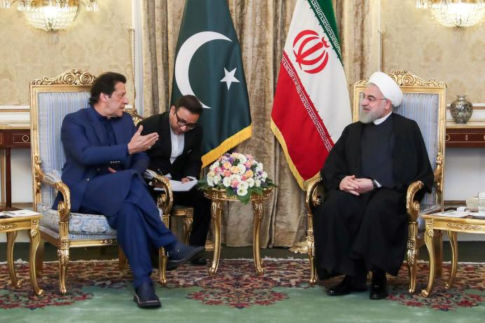 FILE PHOTO: Iranian President Hassan Rouhani meets with Pakistani Prime Minister Imran Khan in Tehran, Iran, October 13, 2019. REUTERS./