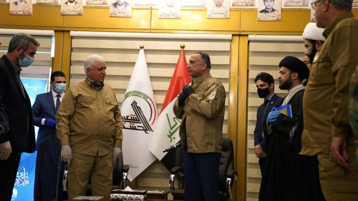 Iraqi Prime Minister al-Kazemi wears a military uniform of Popular Mobilization forces during his meeting with Head of the Popular Mobilization forces Faleh al-Fayyad in Baghdad, Iraq May 16, 2020. REUTERS./