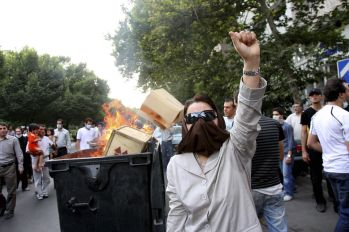 FILE PHOTO: A protester raises her hand during a protest in central Tehran. REUTERS./
