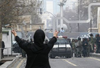EDITORS' NOTE: Reuters and other foreign media are subject to Iranian restrictions on their ability to film or take pictures in Tehran. A female protestor gestures in defiance against the crackdown by security forces during clashes in central Tehran December 27, 2009. A senior Iranian police official denied a report on an opposition website that four pro-reform protesters were killed during clashes in Tehran on Sunday, the Students News Agency ISNA reported. REUTERS/Stringer (IRAN - Tags: POLITICS CIVIL UNREST IMAGES OF THE DAY)