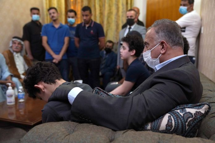 Iraqi Prime Minister Mustafa al-Kadhimi visits and offers condolences to the family of the late former government advisor and political analyst Hisham al-Hashemi, who was killed by gunmen, in Baghdad, Iraq July 8, 2020.