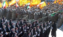 FILE PHOTO: Members of Iran's basij militia force march during a military parade south of Tehran. REUTERS./