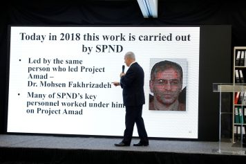 Israeli Prime Minister Benjamin Netanyahu points at a screen with an image of Iranian nuclear scientist Mohsen Fakhrizadeh during a news conference at the Ministry of Defence in Tel Aviv, Israel, April 30, 2018. REUTERS/ Amir Cohen