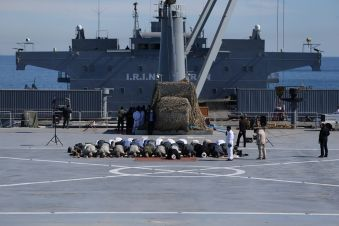 Iranian military commanders and other members of the armed forces pray on the Iranian-made warship Makran during an exercise in the Gulf of Oman, January 13, 2021. Picture taken January 13, 2021. REUTERS./