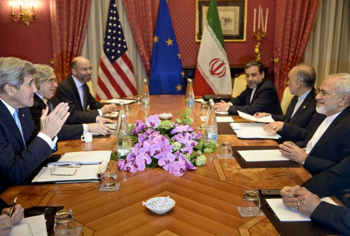 FILE PHOTO: U.S. Secretary of State John Kerry, U.S. Secretary of Energy Ernest Moniz, Robert Malley, member of the U.S. National Security Council, Iranian Deputy Foreign Minister Abbas Araghchi, Head of Iran Atomic Energy Organization Ali Akbar Salehi, and Iranian Foreign Minister Javad Zarif wait to start a meeting at the Beau Rivage Palace Hotel in Lausanne March 29, 2015. REUTERS/Brendan Smialowski/Pool/File Photo