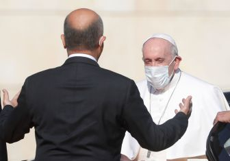 Iraqi President Barham Salih welcomes Pope Francis at the Presidential Palace during his historic tour in Baghdad, Iraq, March 5, 2021. REUTERS/Yara Nardi