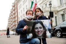 Richard Ratcliffe, husband of British-Iranian aid worker Nazanin Zaghari-Ratcliffe, and their daughter Gabriella protest outside the Iranian Embassy in London, Britain March 8, 2021. REUTERS/Andrew Boyers