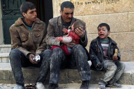 FILE PHOTO: A man holds a baby saved from under rubble, who survived what activists say was an airstrike by forces loyal to Syrian President Bashar al-Assad in Masaken Hanano in Aleppo, Syria February 14, 2014. REUTERS/Hosam Katan/File Photo