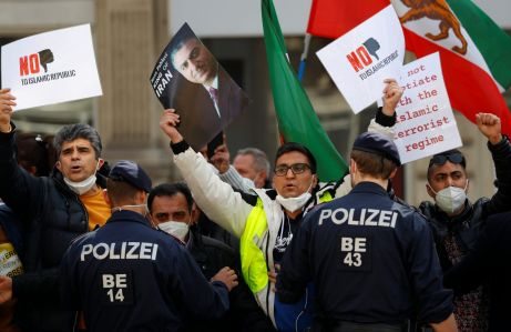 An Iranian opposition group protests outside a hotel, during a meeting of the JCPOA Joint Commission, in Vienna, Austria, April 9, 2021. REUTERS/Leonhard Foeger