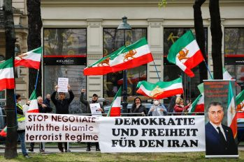 FILE PHOTO Iranians protest against the Iranian regime outside during a meeting of the Joint Commission of the Joint Comprehensive Plan of Action (JCPOA), in Vienna, Austria, April 20, 2021. REUTERS/Leonhard Foeger