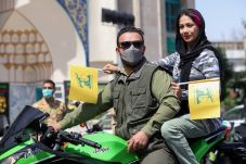 Regime backed individuals ride on a motorbike as they take part in a rally marking the annual Quds Day, or Jerusalem Day, in Tehran, Iran May 7, 2021. REUTERS./