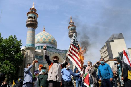 Regime backed groups burn a U.S. flag during a rally marking the annual Quds Day, or Jerusalem Day, in Tehran, Iran May 7, 2021. REUTERS./