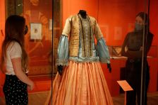 V&A employees look at Woman's jacket, blouse and skirt 1840-50 on display at Epic Iran, an exhibition soon to open at the V&A in London, Britain, May 25, 2021. Picture taken May 25, 2021. REUTERS/Peter Nicholls