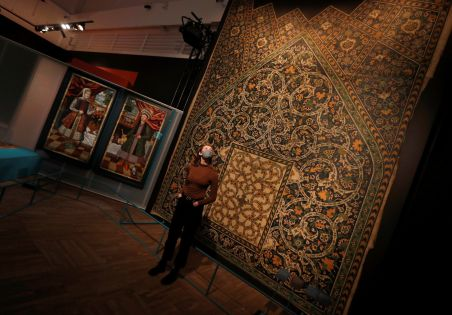 A V&A employee looks up at a full size replica of tiles from Isfahan on display at Epic Iran, an exhibition soon to open at the V&A in London, Britain, May 25, 2021. Picture taken May 25, 2021. REUTERS/Peter Nicholls
