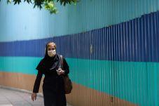 An Iranian Woman walks on a street in Tehran, Iran May 26, 2021. REUTERS./