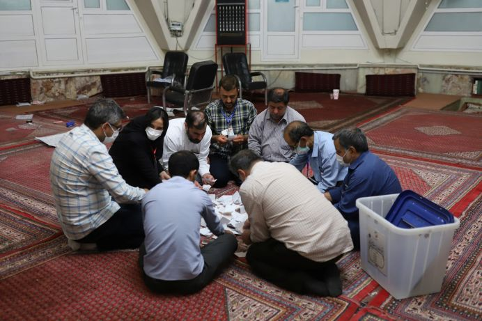 Electoral staff count ballots in a polling station after voting ended in the presidential election in Tehran, Iran June 19, 2021. REUTERS./